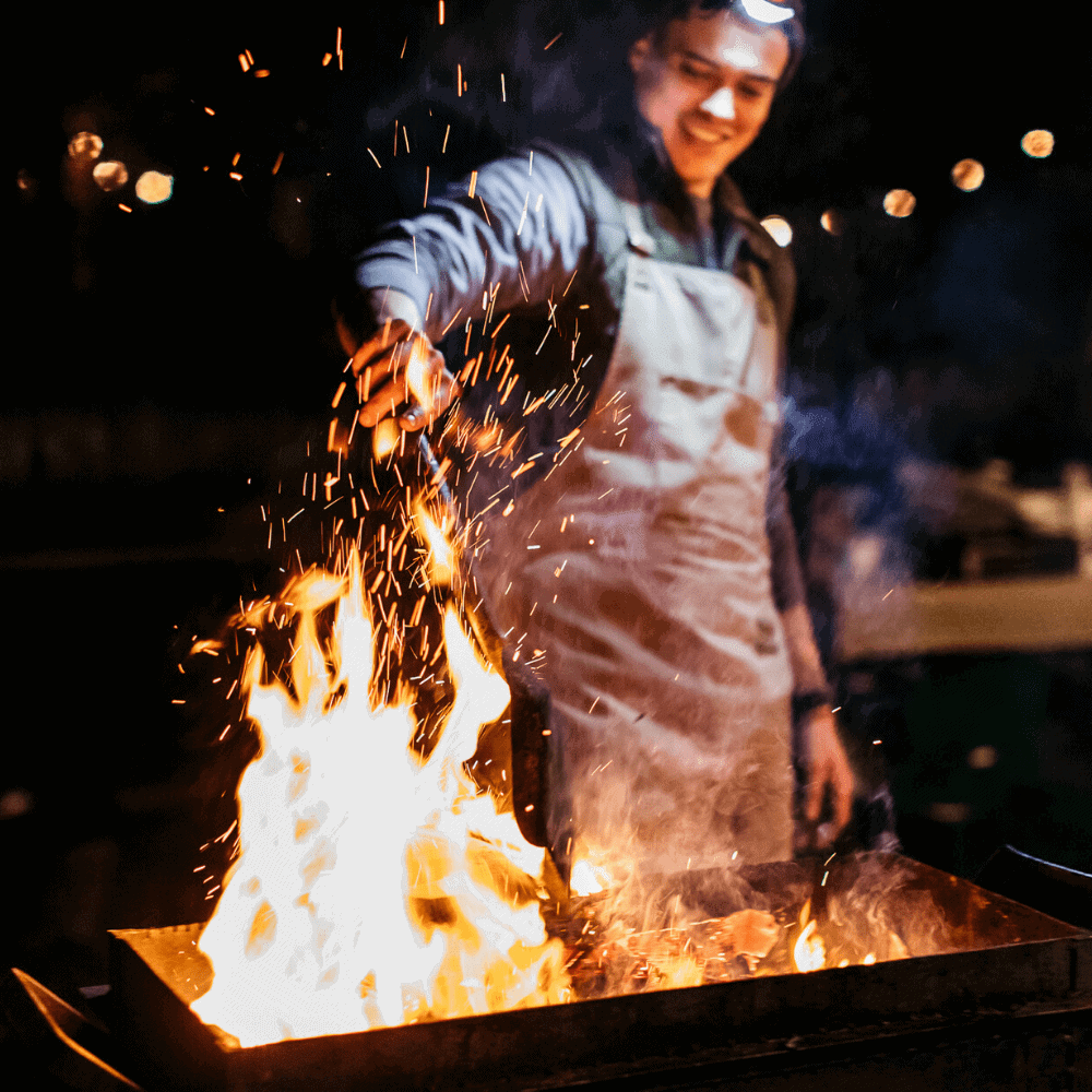 Christian cooking over fire at The Salt Box