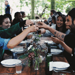 Guests toasting with a glass of wine at a woodland supper club